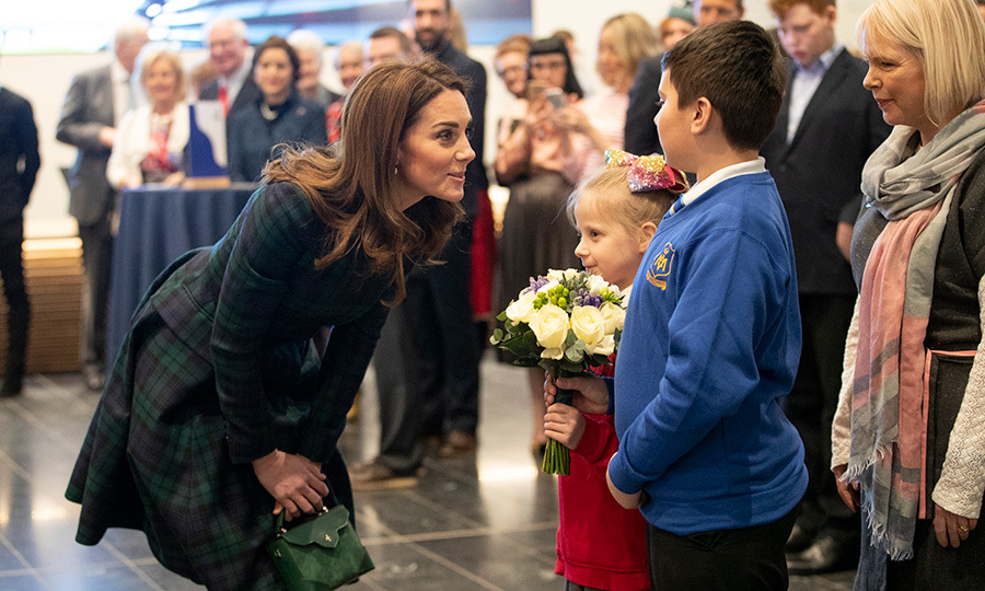 Kate recieved flowers from Debbie Gray, of Rosebank Primary School, and Sean Edgar, from Our Lady's Primary School, during a visit to officially open the V&A Museum.