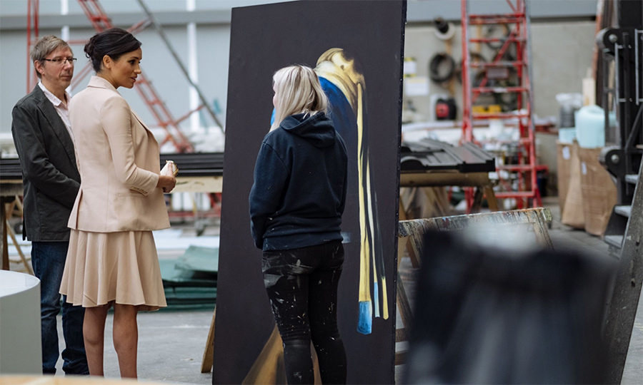 Meghan chatted with one apprentice and took a look at one of her pieces of art.