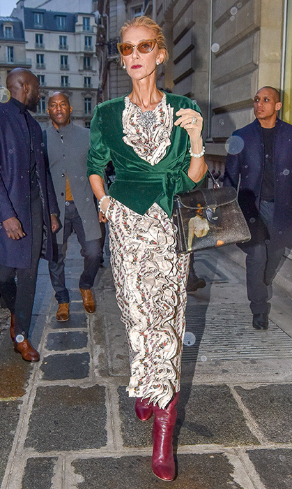 Celine looked every inch the style star on Jan. 25 when she stepped out in a patterned dress, red leather boots, an emerald-green velvet jacket and the best cat-eye sunnies.