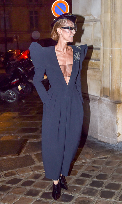 Talk about making a statement! That evening, the chanteuse made jaws drop in a deep V-neck jumpsuit, paired with a sheer bandeau underneath, a netted fascinator, slim 90s-style sunglasses and a pair of patent leather booties.