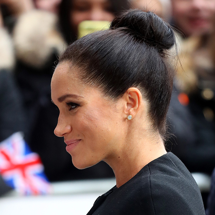 Meghan styled her dark hair up in a top knot and as for makeup, the 37-year-old let her natural beauty shine through with minimal products – a nude lip and a simple smoky eye. She appeared to be wearing her her 'Midi Knockout' earrings by Canadian jewellery designer Dean Davidson.