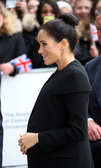 Meghan looked fresh and happy as ever to discuss a cause very important to her – education.