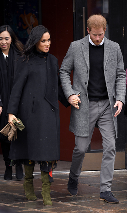 A little bit of snowy weather didn't stop Meghan from bringing out her best in fashion sense! Though the duchess was bundled up for the cold, a bit of her Oscar de la Renta belted printed silk-chiffon dress peeked out from beneath her elegant black coat. Her boots, by Sarah Flint, were the ultimate accessory to bring some colour to the blustery day. She held a green clutch to match.