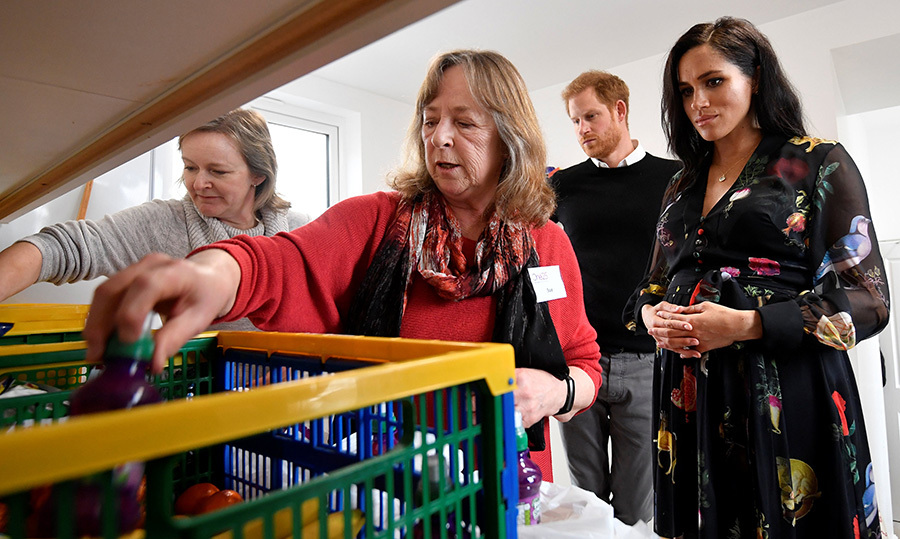 The couple helped volunteers in the kitchen as they packed food parcels to go in the charity outreach van.