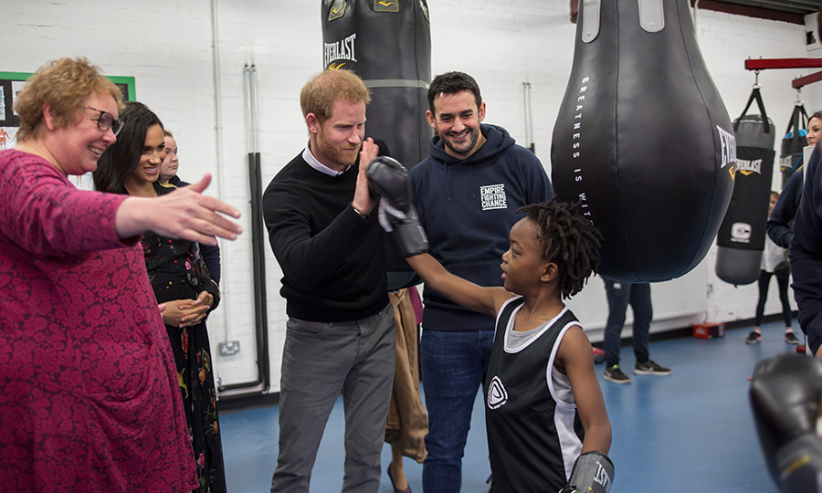 The couple met with seven-year-old Aziah Selassie during their visit, and Prince Harry helped the young boy practice his punches.