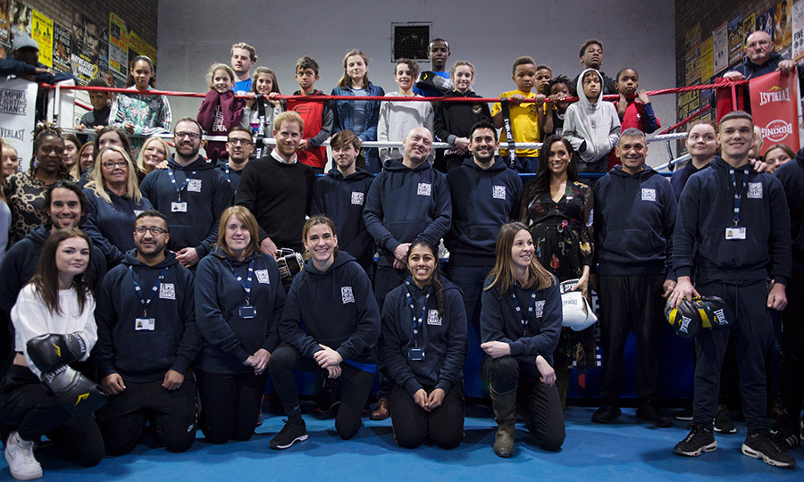 The Sussexes posed with members of the boxing gym.