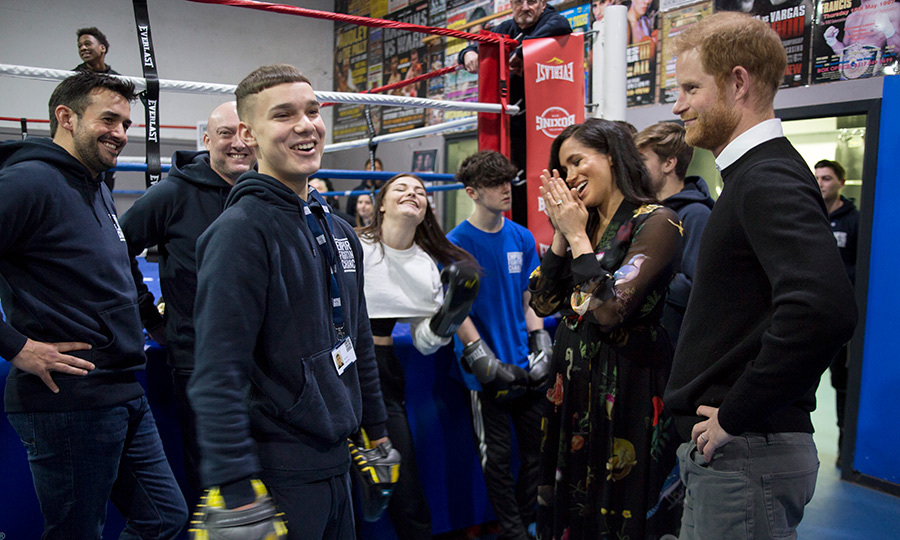 Meghan couldn't contain her laughter while they chatted with members of the gym.