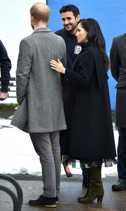 While in Bristol on Feb. 1, the Duchess of Sussex comforted her husband by placing a hand on his back.