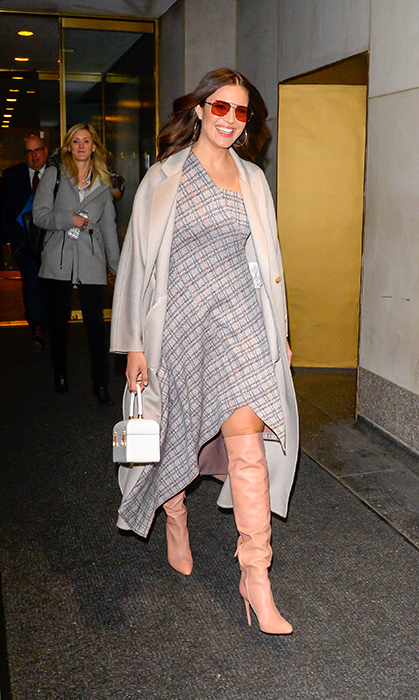 On Feb. 4, Mandy Moore was positively beaming while leaving <em>The Today Show</em> in a asymmetrical patterned dress and slouchy pink boots.