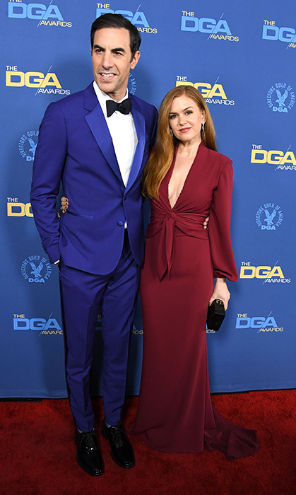 Sacha Baron Cohen and Isla Fisher made one handsome couple at the 71st Annual Directors Guild of America Awards on Feb. 2. The actress stunned in a plunging maroon gown, while her husband looked dapper as ever in a blue tuxedo.