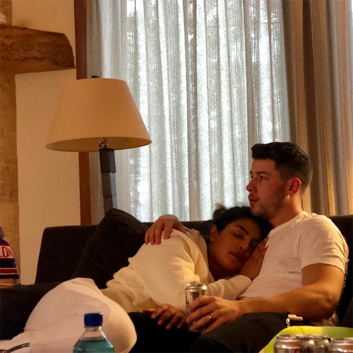 "Priyanka Chopra and Nick Jonas cuddled up on their couch for a weekend night in. The <em>Quantico</em> star simply captioned the sweet snap: ""Home"".