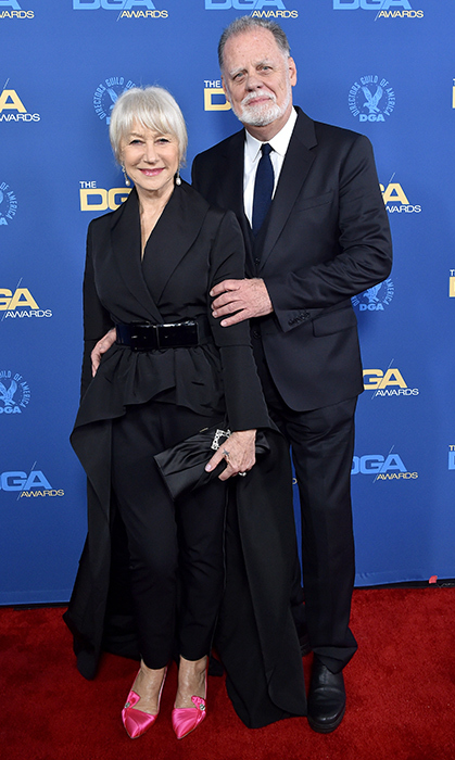 Helen Mirren and her husband Taylor Hackford posed together on the 71st Annual Directors Guild of America Awards' red carpet. The actress dazzled in a black ensemble, spicing things up with a pair of hot pink shoes.
