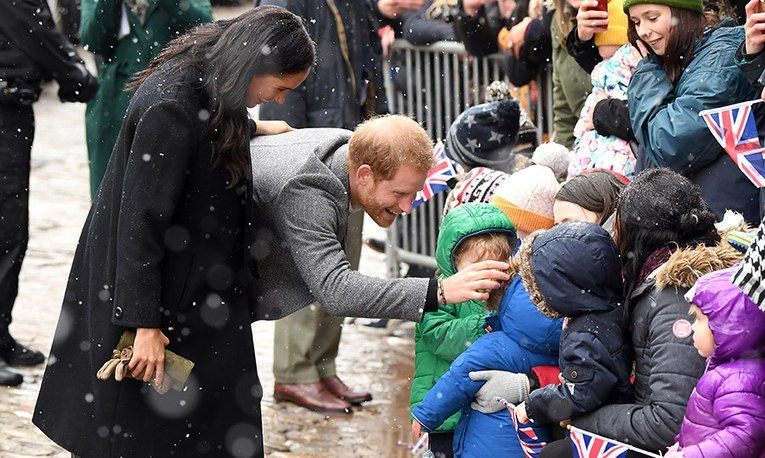 The Duke and Duchess of Sussex rang in the first day of February with a snowy trip to Bristol! After back-to-back appearances by the pregnant royal at the end of January, she joined her husband for packed day in the city. During a walkabout, the two had an adorable encounter with a gaggle of kids.