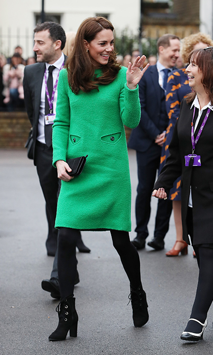 Kate looked no further than London-based bespoke brand Eponine. The duchess wowed in the bright green jumper ensemble, paired with the chicest of lace-up booties and opaque black tights to make the colour really pop. As always, the 37-year-old wore her beautiful hair in bouncy, voluminous waves and accessorized with and a small black clutch.