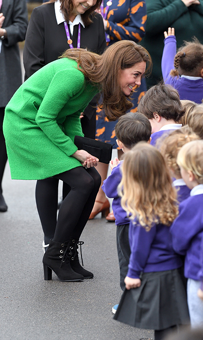 The duchess chatted excitedly with an adorable gaggle of kids.