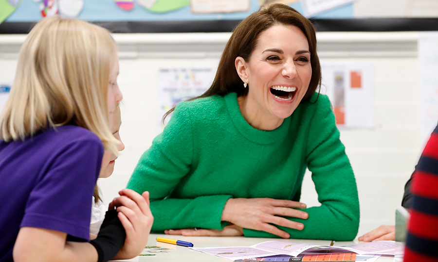 While chatting with a group of school kids, the duchess let out a hearty laugh!
