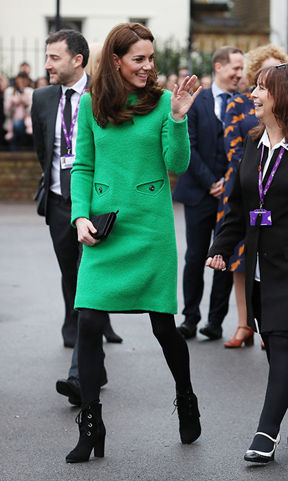 While stepping out in support of Place2Be to commemorate the start of Children's Mental Health Week on Feb. 5, Kate looked no further than London-based bespoke brand Eponine. The duchess wowed in the bright green jumper ensemble, paired with the chicest of lace-up booties and opaque black tights to make the colour really pop. As always, the 37-year-old wore her beautiful hair in bouncy, voluminous waves – and she didn't forget her megawatt smile while visiting with students taking part in a club which focuses on wellbeing. As for accessories, the duchess held a small black clutch and recycled her CA$3,115 diamond leaf earrings by Kiki McDonough.
