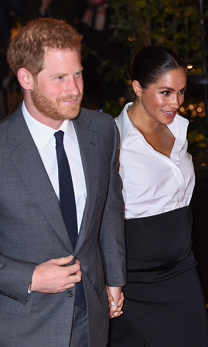 Meghan's beauty look was absolutely glowing, while her handsome husband looked dapper as ever in a grey suit.