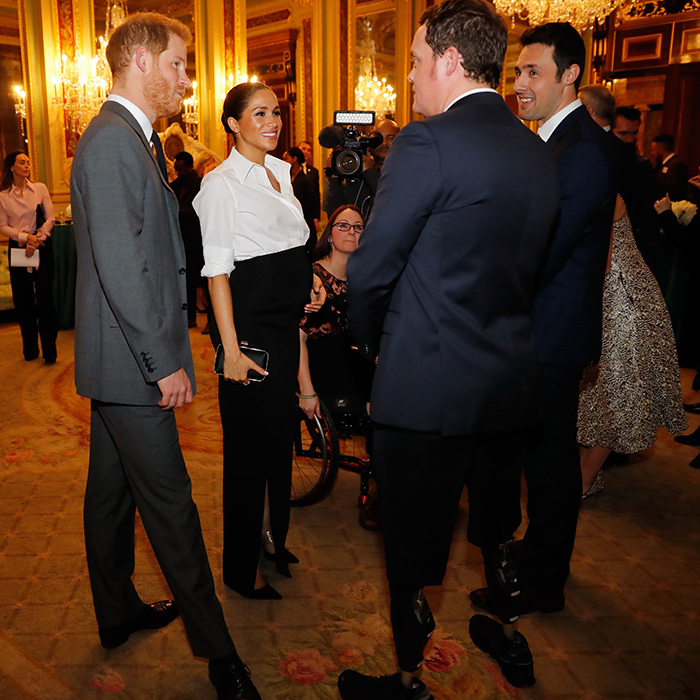 Prince Harry and Meghan chatted with two men up for an award that evening.