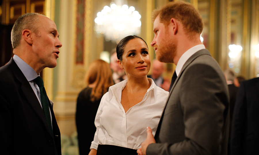 Oh, those looks of love! Meghan listened intently as her husband chatted away.