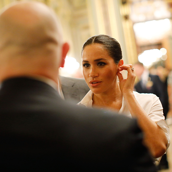 She adjusted one of her Vanessa Tugendhaft Precious Earrings while talking to a guest.