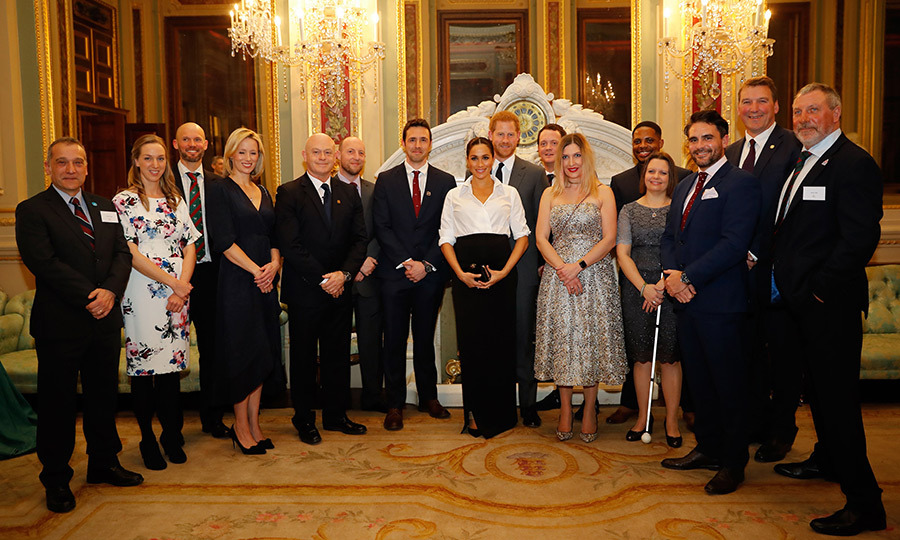 The Sussexes posed with the nominees and guests at the night's pre-ceremony reception.