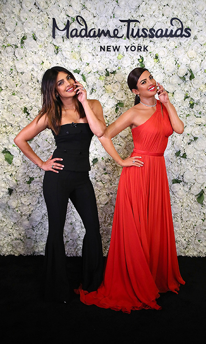 We're seeing double! Priyanka Chopra met her double at Madame Tussauds... Can you spot who's who?
