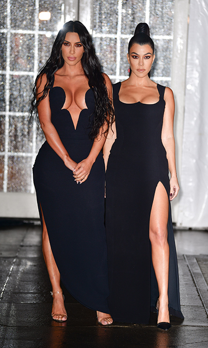 Kim and Kourtney Kardashian made head turns in their stunning gowns at the amfAR Gala in New York City. The sisters were matching in jet-black Versace gowns for the glitzy evening.