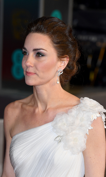 The mother of three's natural beauty shone through. Keeping her brunette locks in a chic updo, the duchess amped up her classic smoky eye with some liner, and a simple swipe of pink on her lips. Kate wore a stunning pair of diamond-and-pearl earrings that one belonged to her late mother-in-law Diana, Princess of Wales.