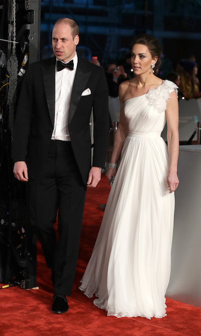 Duchess Kate was an absolute vision in a white one-shoulder Alexander McQueen silk crepe gown with floral appliqué, while Prince William looked dapper in a classic black tuxedo.