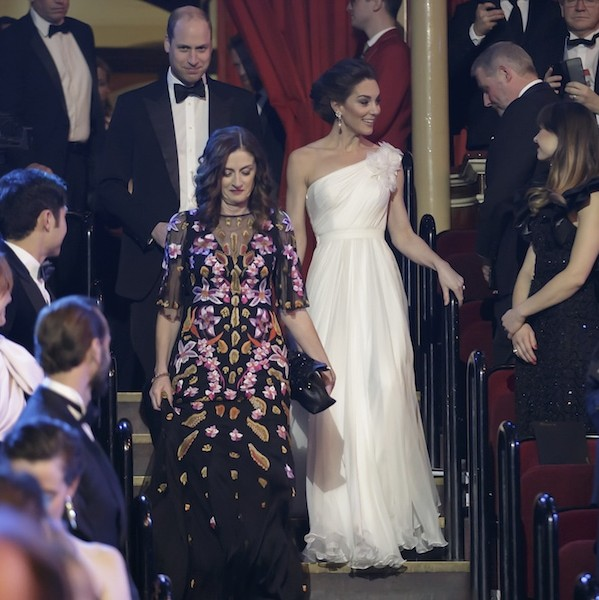 The audience rises as the Duke and Duchess of Cambridge make their way to their seats for the show.