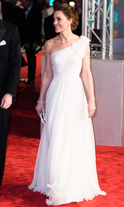 The Duchess of Cambridge was a vision in white Alexander McQueen for the 2019 BAFTAs on Feb. 10. Walking the red carpet with her husband, Prince William, the mother of three turned heads in the one-shoulder gown, decorated with floral appliqué on the shoulder and boasting a flattering empire waistline. She accessorized the look with a pair of diamond and pearl earrings once owned by her late mother-in-law, Princess Diana, as well as a diamond bracelet, Jimmy Choo Romy 100 Delivered with Chocolates style pumps and a white clutch, thought to be a bespoke piece by Alexander McQueen.