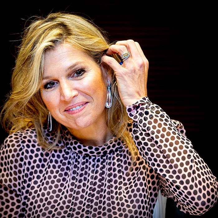 Queen Maxima looked beautiful during her visit, accessorizing her designer dress with a pair of drop earrings and a simple makeup look.
