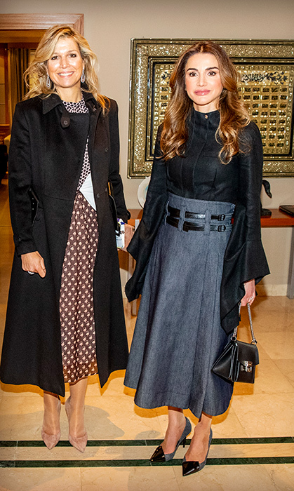 The Dutch royal dazzled in a beautiful contrasting dress by Giambattista Valli for day two in the country. Máxima kept warm in a black coat, anchoring the look with a pair of suede beige pumps. Rania looked equally as stunning in a grey skirt and black blouse, with a matching handbag and pair of heels.
