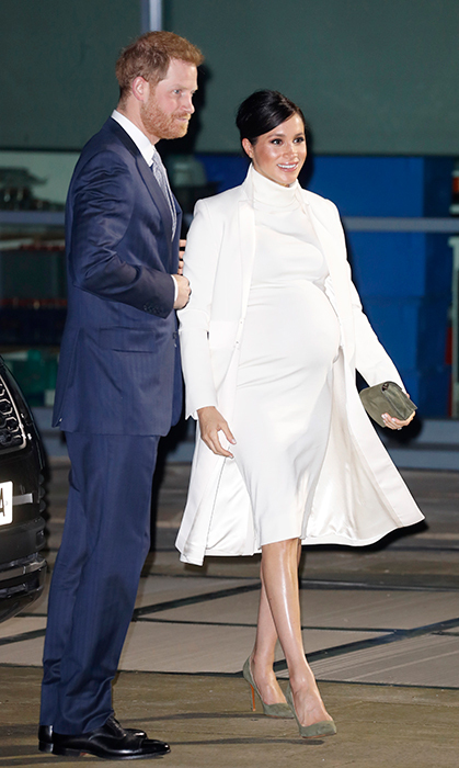 The duchess looked wonderful in white, opting for an elegant knee-length dress by Calvin Klein and a matching Amanda Wakeley coat – the same one she wore in March 2018 for Commonwealth Day with Harry, Prince William and Duchess Kate.