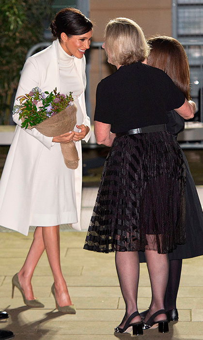 Meghan was given a gorgeous bouquet of flowers as she and her husband, Prince Harry, were greeted by museum officials.