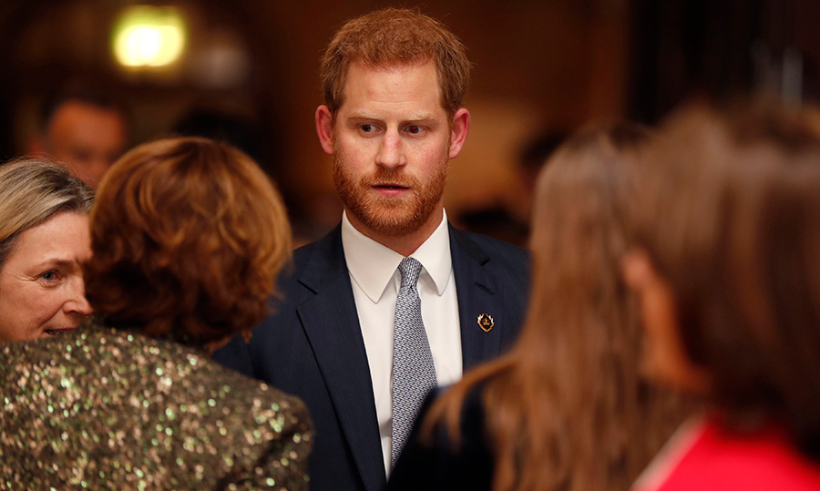 Father-to-be Prince Harry chatted with some guests at the event.