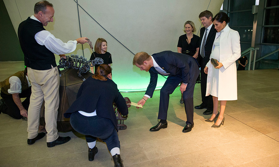 Prince Harry reached for his ticket from a turtle puppet as Meghan looked on in delight.These were just a few of the handmade puppets used in the production.