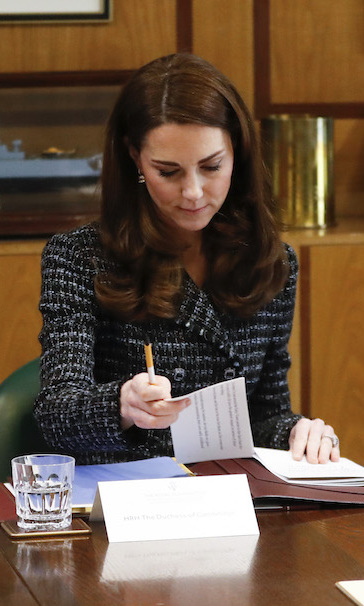 Kate looked studious as ever while taking a look over some documents.