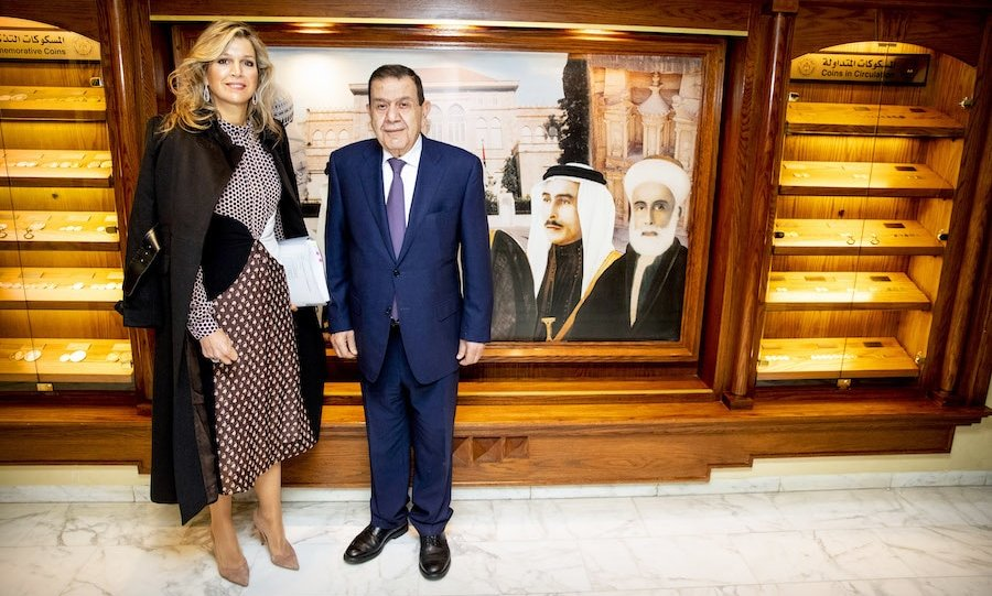 While meeting with Dr. Ziad Fariz of the Central Bank on Feb. 12 during her trip to Jordan, Queen Máxima dazzled in a contrasting dress by Giambattista Valli. She paired the number with beige suede pumps and an elegant black coat, styling her hair in beautiful bouncy blonde waves.
