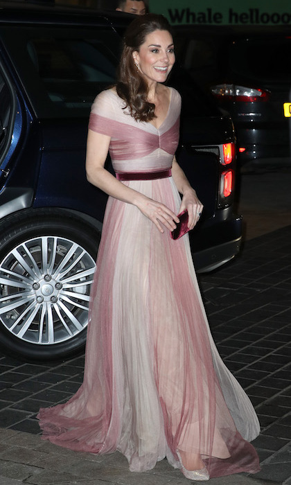 Duchess Kate look glamorous as ever while arriving for her second outing of the day! She dazzled in an ethereal Gucci gown, paired with a velvet Prada bag, Kicki McDonough earrings and Oscar de la Renta pumps.