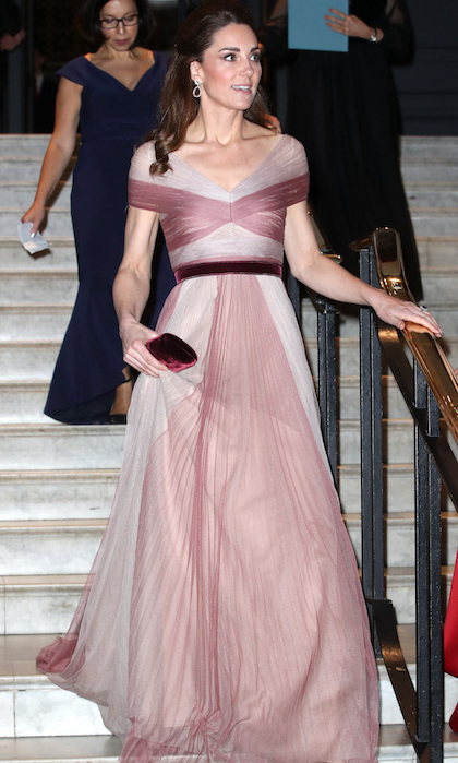 Kate's romantic evening gown flowed beautifully down the stairs as she entered the Victoria and Albert Museum. Not only is she a patron of the evening's initiative, she's also a patron of the museum itself!