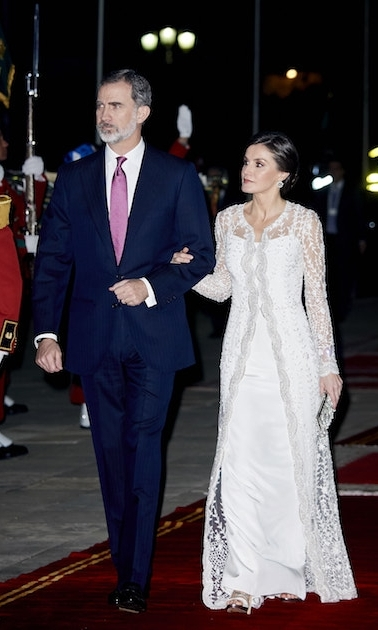 Letizia amped up the glam for a gala dinner at Morocco's royal palace on Feb. 13. Beside her dapper husband, she stunned in a lacey white gown paired with a small beaded clutch, white pumps and a chic up do.