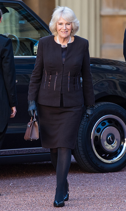 The Duchess of Cornwall never fails to put together an elegant look! While hosting a reception for The London Taxi Drivers' Charity for Children at Buckingham Palace on Feb. 14, Prince Charles' wife stunned in a black skirt suit, gloves and a brown leather handbag.