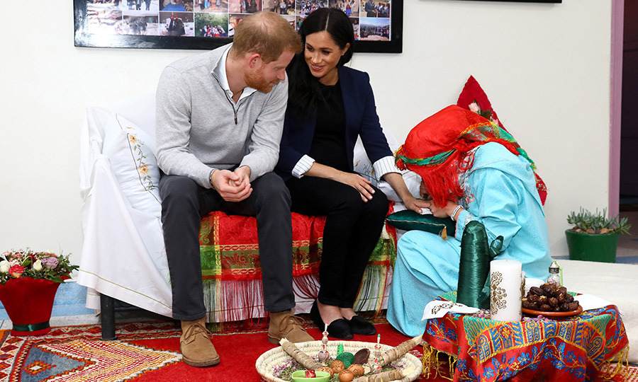 Meghan received some beautiful henna during their visit. The couple shared a sweet moment during the cultural process.