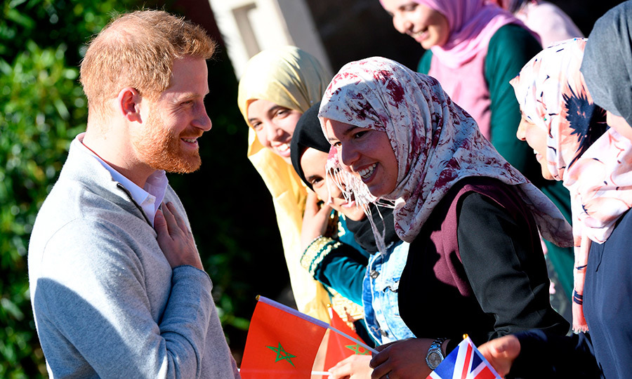 Prince Harry showed off his natural charm, chatting with a pair of women who looked overjoyed to be meeting the prince.