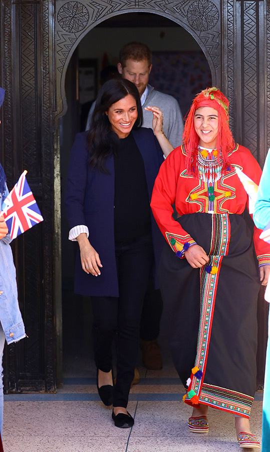 Meghan was positively glowing as she and Harry left the boarding house to stop by Lycée Qualifiant Grand Atlas, a secondary school in the area.