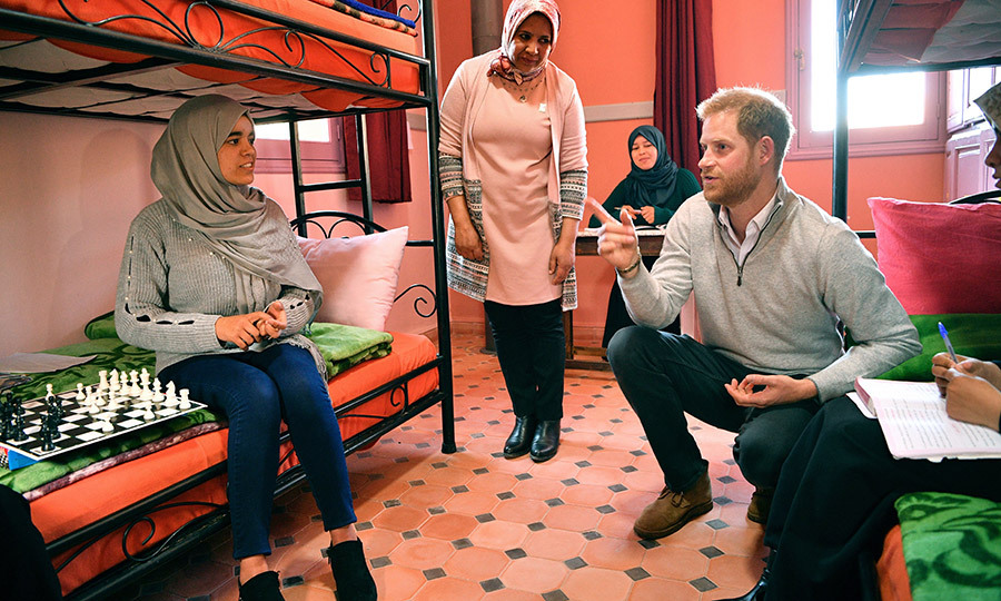 Prince Harry chatted with a young girl at a boarding house in the town of Asni.