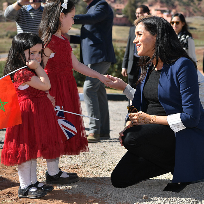 Duchess Meghan jogged over to meet two adorable little girls, Rania and Rayhanna, while in Asni.