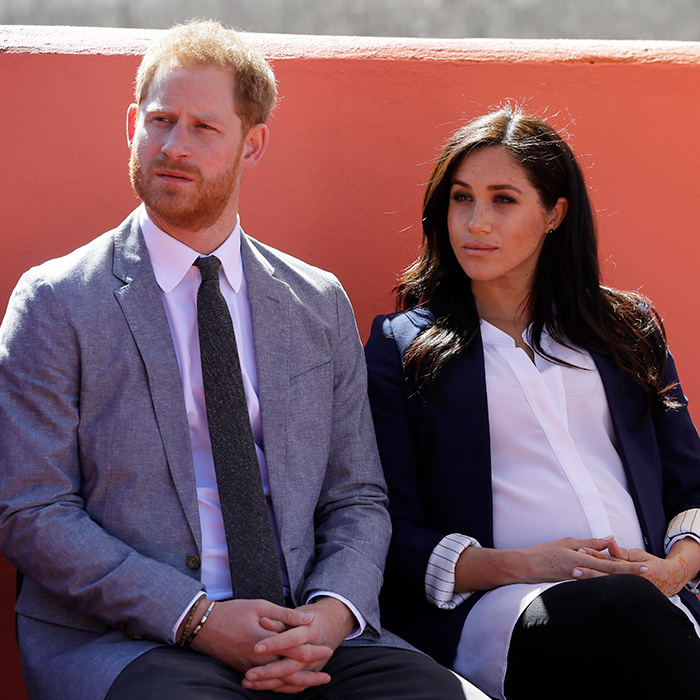 The couple listened to a speech at the investiture.